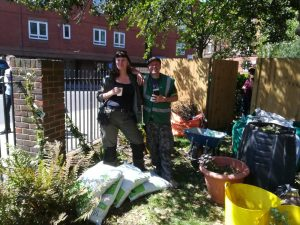 smiling workers in garden at cardinal hume centre london sw1